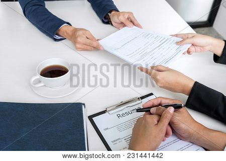 Interviewer Or Board Reading A Resume During A Job Interview, Employer Interviewing A Young Male Job