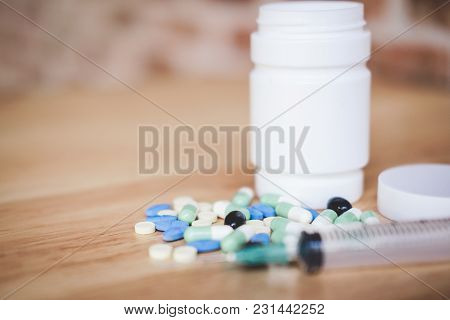 Medicine Supplement And Drug On Wooden Background, Close Up Of Capsule, Syringe And Different Kind O