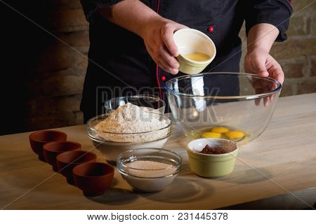 Homemade cooking food recipe by cook hands. Flour, sugar and eggs in glass on home kitchen table background.