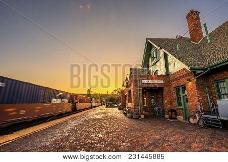 Flagstaff, Arizona, Usa - May 16, 2016 : Amtrak Train Going Through The Historic Train Station In Fl