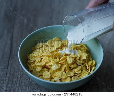 Pour The Milk In A Bowl With Cereal