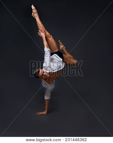 Dancer Dances In A White Shirt And Black Shorts