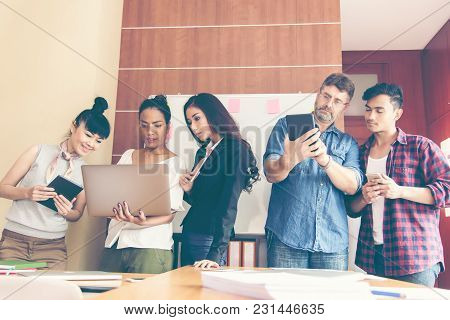 Group Of Businesspeople Using A Digital Tablet Together In Office.  Business Teamwork Partners  Meet