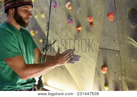 Sportsman In A Boulder Hall Rubs Your Hands With Chalk, Preparation Climbing Sport