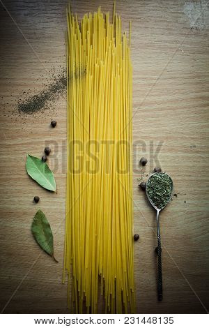 Pasta With Herbs On A Wooden Table
