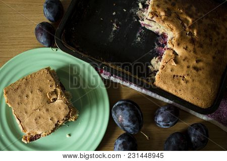 Plum Cake And Plums On A Wooden Table