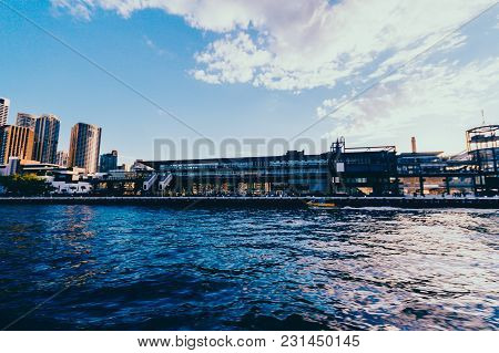 Sydney, Australia - July 12th, 2013: View Of Circular Quay And Sydney Harbour Docks With Sun Flare