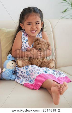 Happy Adorable Little Girl Hugging Her Teddy Bear