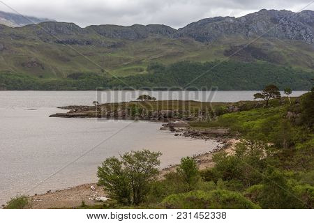 Slattadale, Scotland - June 10, 2012: Section Of Gray Loch Marlee With Peninsula And Forested Shore