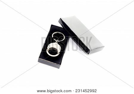 New Keychain On Keys In A Black Box On A White Background Close-up