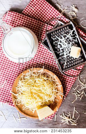 Ingredients For Pasta Dish Or Pizza - Milk, Freshly Grated Parmesan Cheese On A Wooden Table, And Ki