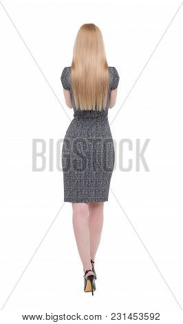 Young Blonde Businesswoman In Gray Dress Back View, Isolated On White