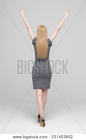 Happy Businesswoman Hands Up On Gray Background, Arms Raised