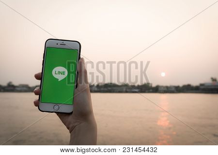 Nonthaburi, Thailand - February 2 ,2018: Hand Holding Screen Shot Of Line Application Showing On Iph