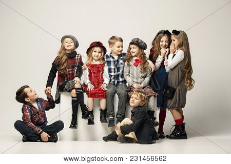 The Group Of Beautiful Girls And Boys On A Pastel Background