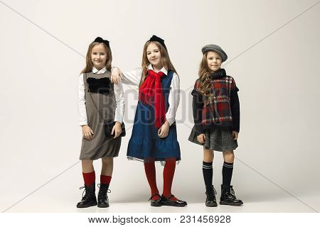 The Fashion Portrait Of Young Beautiful Teen Girls In Dress At Studio. The Beauty, Fashion, Glowing,