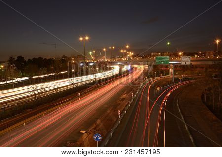 Tehran, Iran - March 15, 2018 Car Light Traces From Moving Cars On Highway At Dusk Time