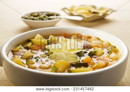 French Vegetable Soup, Soupe Au Pistou, Made From Summer Vegetables, With Pistou Sauce And Parmesan.