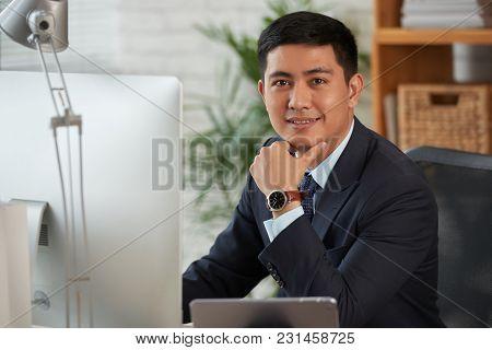 Young Entrepreneur Smiling And Looking At Camera