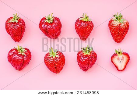 Set Of Strawberries In Two Raws On Pink Background