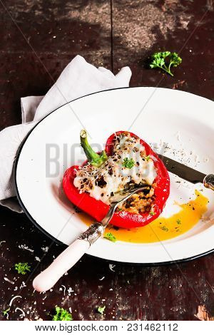 Top View Of Baked In The Oven Red Bell Pepper Stuffed With Minced Pork And Beef Meat, Covered With M