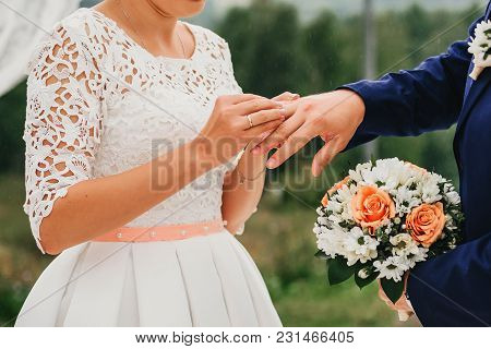 Exchange Of Gold Rings At The Wedding Ceremony Between The Bride And Groom