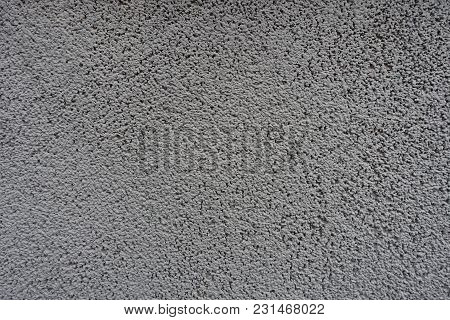 Surface Of Grainy Gray Wall (front View)
