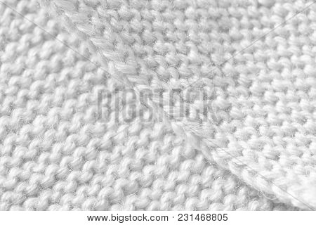 Knitting From Woolen Threads Handmade. The Texture Is White, The Background Of The Canvas Is Connect