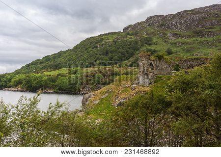 Stromeferry, Scotland - June 10, 2012: Castle Strome Ruins On Green Shore Cliff Over Loch Carron. Cl
