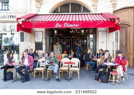 Paris, France-march 11, 2018: The Cafe Les Chimeres Situated In A Busy Corner Of The Place De Saint