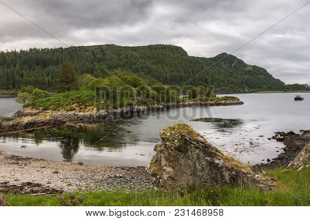 Stromeferry, Scotland - June 10, 2012: Loch Carron Shoreline With Peninsula Under Castle Strome Ruin