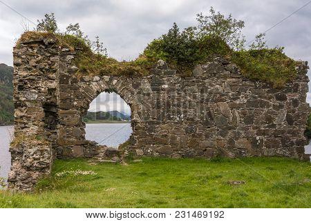 Stromeferry, Scotland - June 10, 2012: Window In Rock Wall Of Castle Strome Ruins On Green Hill. Clo