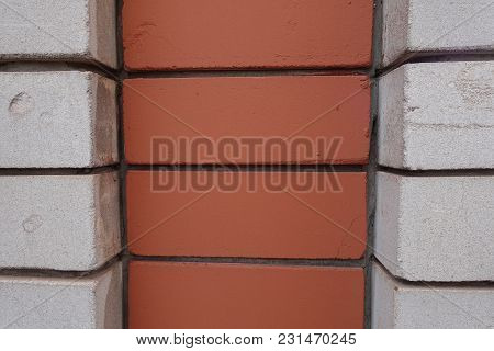 Decorative Relief Brickwork Made Of White And Orange Bricks