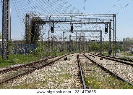Three Rail Tracks Railway With Overhead Electrical Train Line