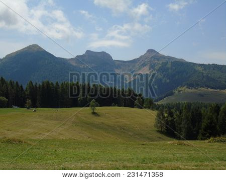 Beautiful Views From The Dolomites In Summer With A Green Park