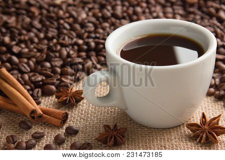 Cup Of Hot Espresso On Beige Cloth Sackcloth With Coffee Beans