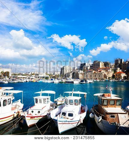 Heraklion Old Venetian Harbour With Colorful Boats Under Blue Sky With Clouds, Crete, Greece