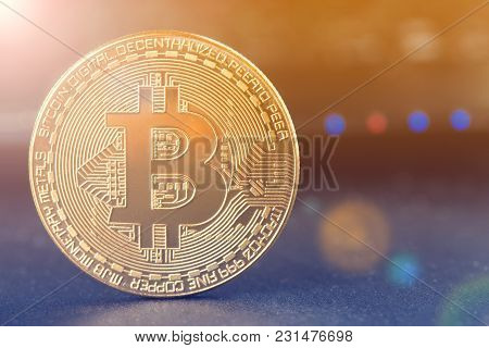Bitcoin And  Physical Bit Coin. Digital Currency. Cryptocurrency. Golden Coin With Bitcoin Symbol