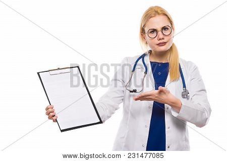 Disappointed Doctor In White Coat And Glasses Wears Stethoscope And Holds Clip Pad And Shows On Blan