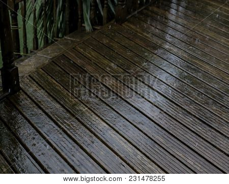 The Rain Falls On The Decking In The Garden During A Storm