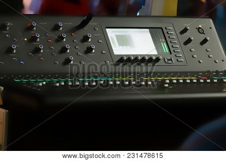 Blurry Background Of Digital Mixer And Fader For Music Recording, Radio Or Tv Broadcasting.