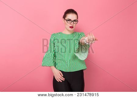 Portrait Of Attractive Businesswoman With Hair Bun In Striped Blouse And Eyeglasses Calling Someone