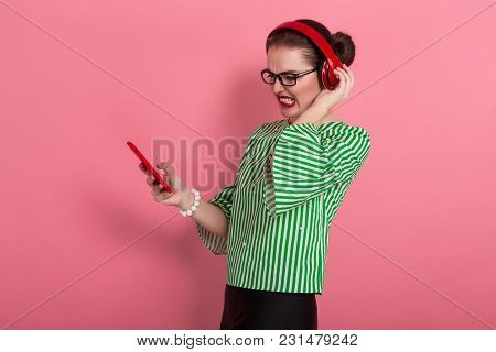 Businesswoman With Phone And Earphones