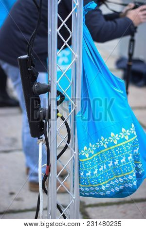 Plugged In Electric Devices In An Extension Cord And A Blue Linen Bag