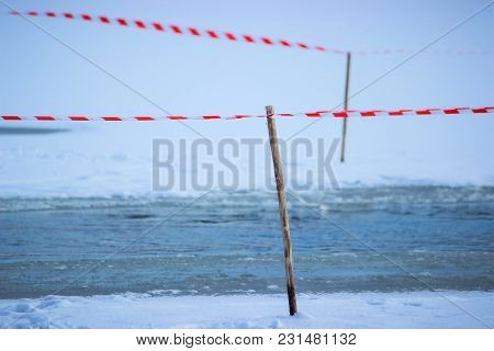 Tape Fence On The Winter River Do Not Cross