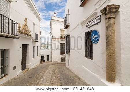 Arcos De La Frontera, Spain - May 2017: View Of The Street In The Old Town Of Arcos. The Road Sign S