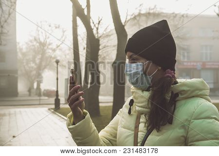Woman Suffering From Sick And Wearing Face Mask. Woman In Protective Mask Feeling Bad On The Street
