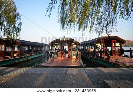 Hangzhou, China - Dec 26, 2017: Traditional Wooden Row Boat On Famous West Lake Hangzhou China