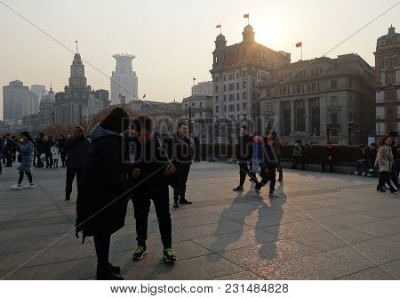 Shanghai, China- Jan 08, 2018: Unidentified People In A The Bund In Shanghai China. The Bund Or Wait