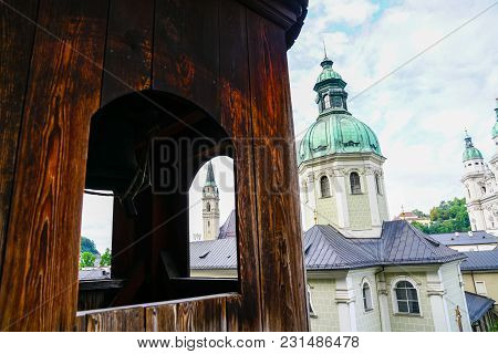 View Through Window To Buildings And Church Dome From Catacombs In Salzburg, Austria